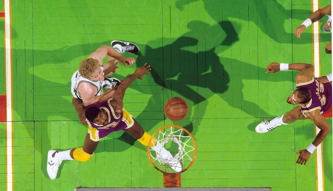 Rival stars Magic Johnson and Larry Bird of the Celtics battle beneath the rim in Game 1 of the 198…