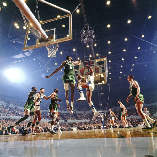 Bill Russell guards the lane against an Elgin Baylor drive during Game 4 of the 1966 NBA Finals bet…