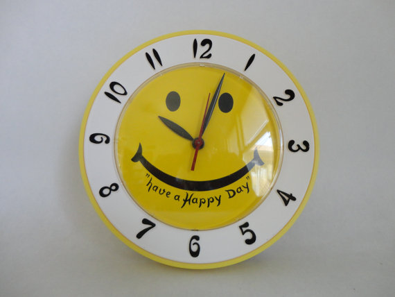 have a happy day...VINTAGE yellow smiley face LUX electric wall CLOCK